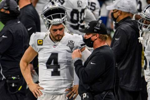 Las Vegas Raiders head coach Jon Gruden talks with quarterback Derek Carr (4) during the first ...