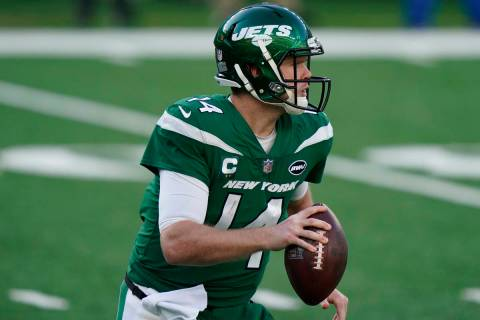 New York Jets quarterback Sam Darnold looks to throw during the first half of an NFL football g ...
