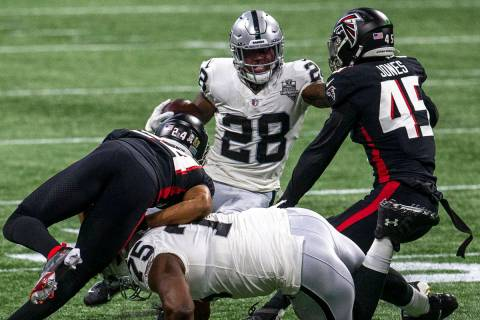 Las Vegas Raiders running back Josh Jacobs (28) runs for more yards against Atlanta Falcons lin ...