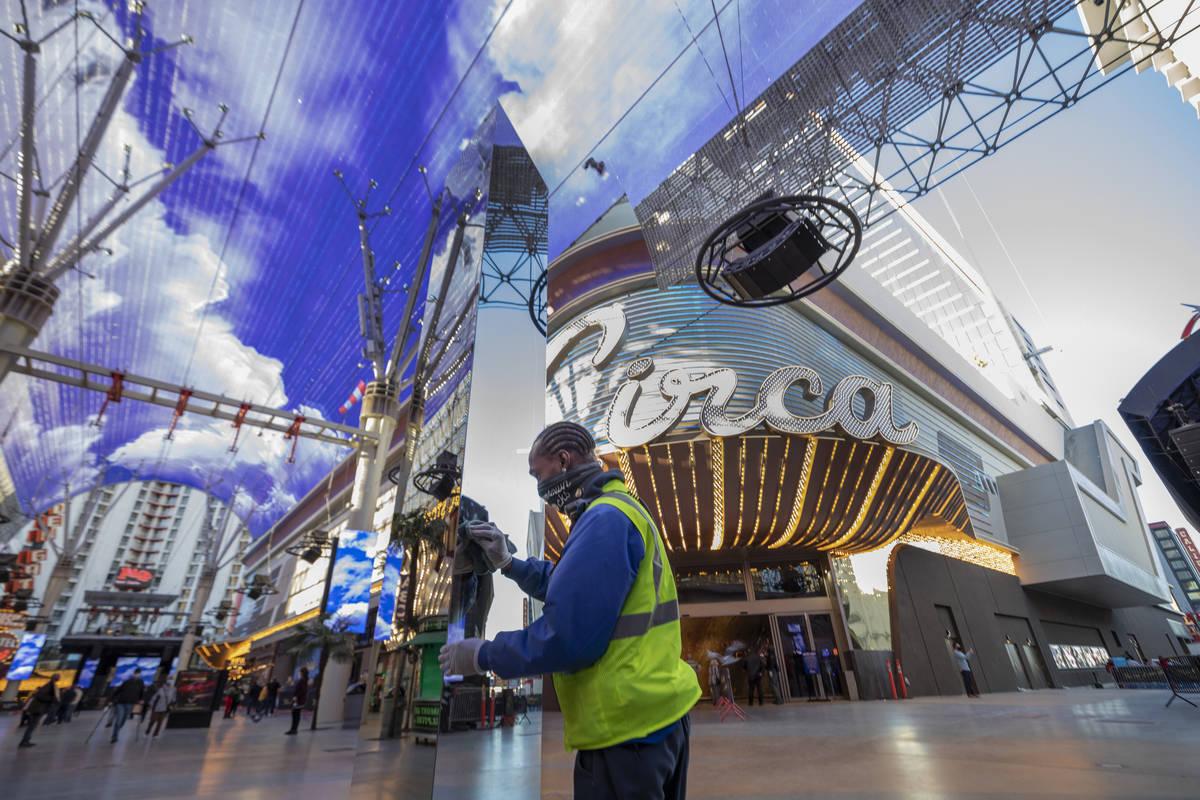 City of Las Vegas detail maintenance Michael Bradley cleans off fingerprints off of a 10-foot m ...