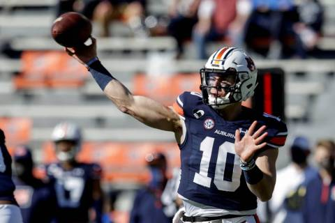 Auburn quarterback Bo Nix (10) throws a pass against Texas A&M during the first half of an NCAA ...