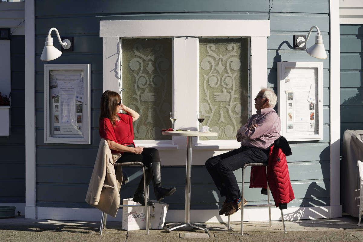 A couple dines outdoors at Scoma's restaurant Friday, Dec. 4, 2020, in Sausalito, Calif. The he ...