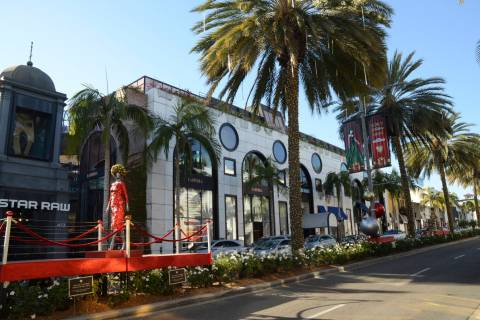Rodeo Drive has less cars and pedestrians doing holiday shopping this year due to the coronavir ...
