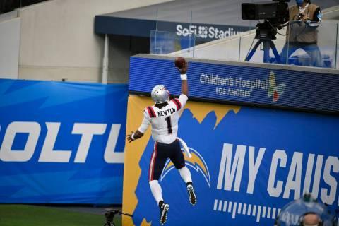 New England Patriots quarterback Cam Newton (1) celebrates after scoring against the Los Angele ...