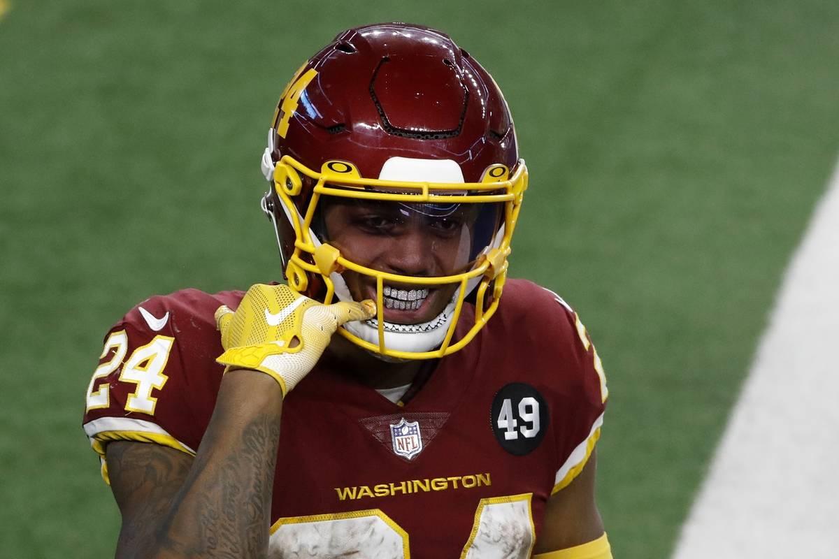 Washington Football Team running back Antonio Gibson (24) points to his mouth as he celebrates ...