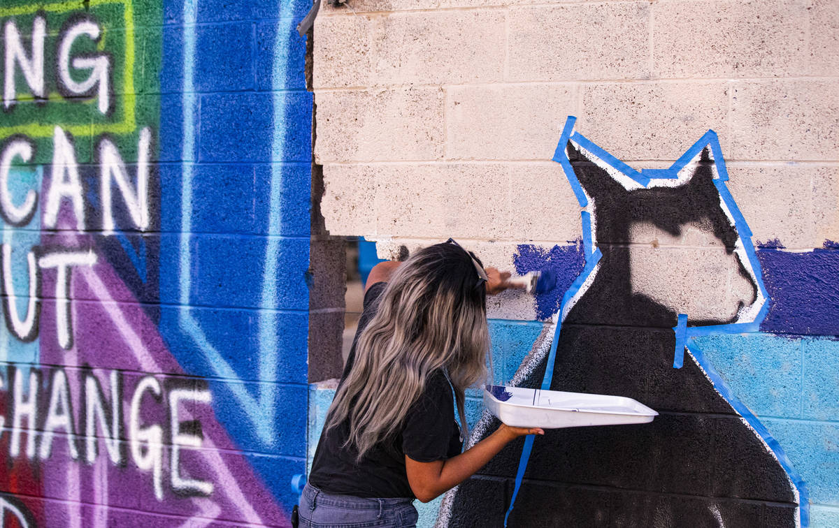 Kayla Bunting, of Henderson, work on a mural at the site of the former Moulin Rouge in Las Vega ...