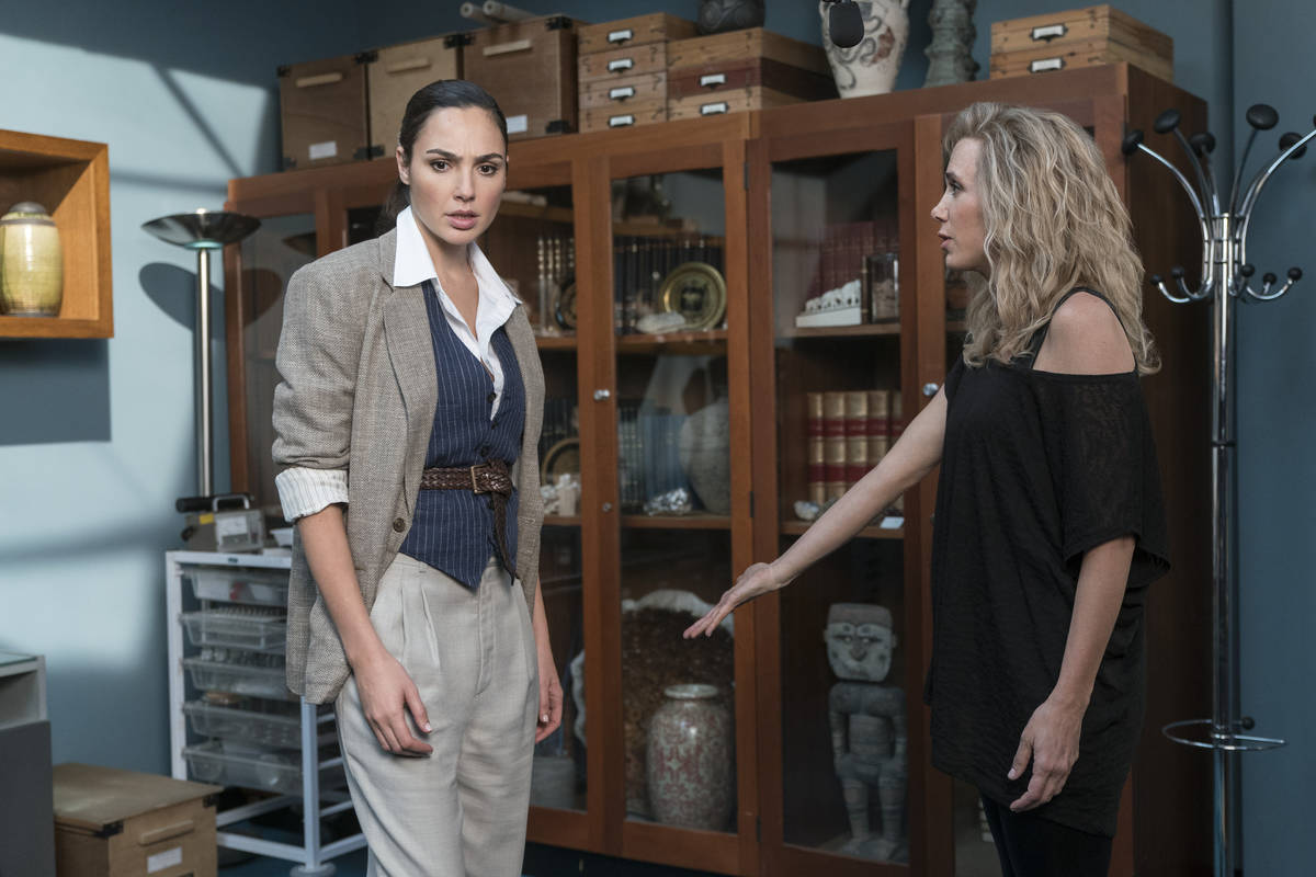 "Gal Gadot, left, stars as Diana Prince and and Kristen Wiig as Barbara Minerva in ""Wonder Woman ..."