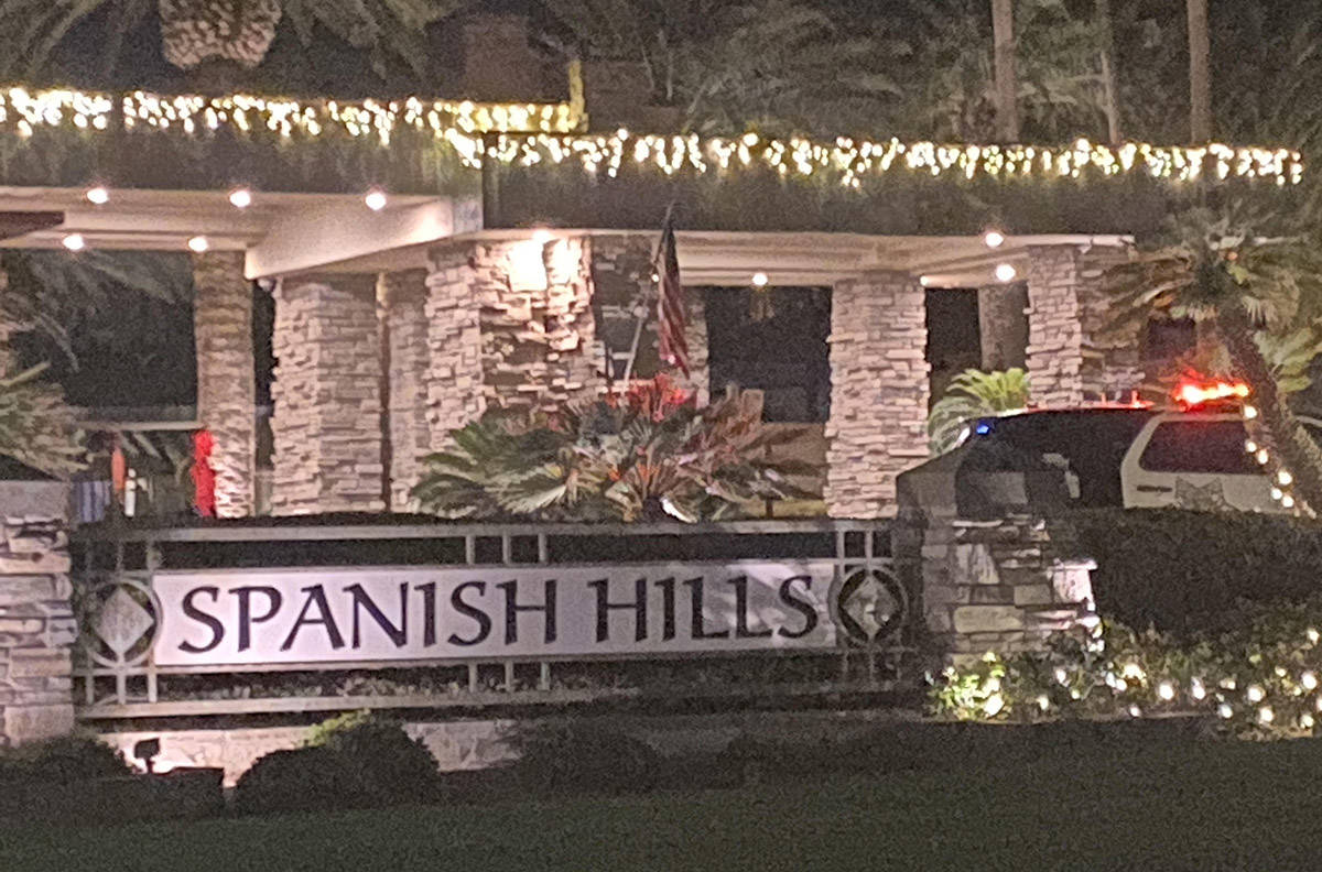 A Las Vegas police SUV at the entrance to the Spanish Hills subdivision where an officer-involv ...