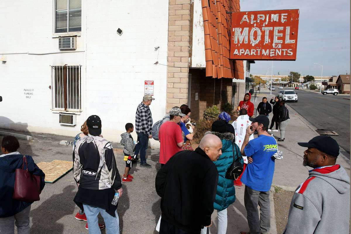 Residents gather at Alpine Motel Apartments on Dec. 21, 2019, after a fire left six dead and 13 ...