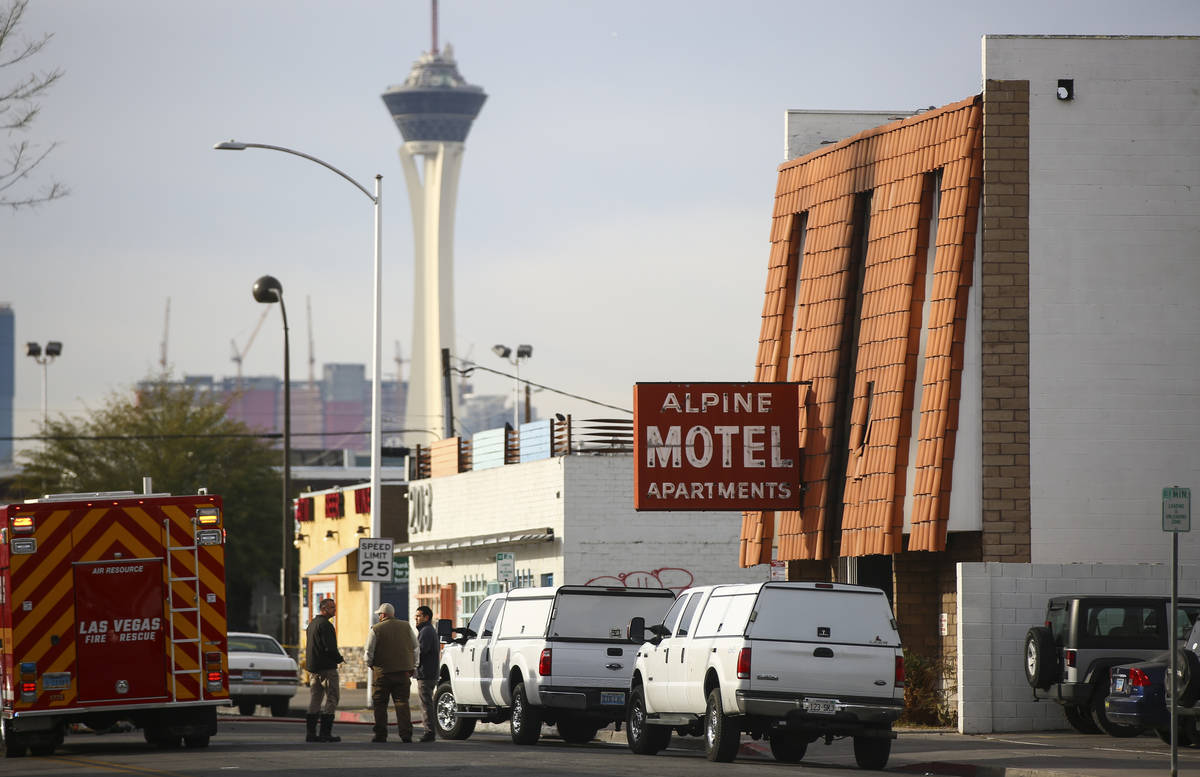 Las Vegas firefighters respond to the scene of a fire at the Alpine Motel Apartments on Dec. 21 ...