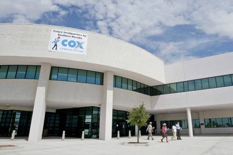 Patrons walk out of the new headquarters for Cox Communications in Las Vegas on Vegas Drive nea ...