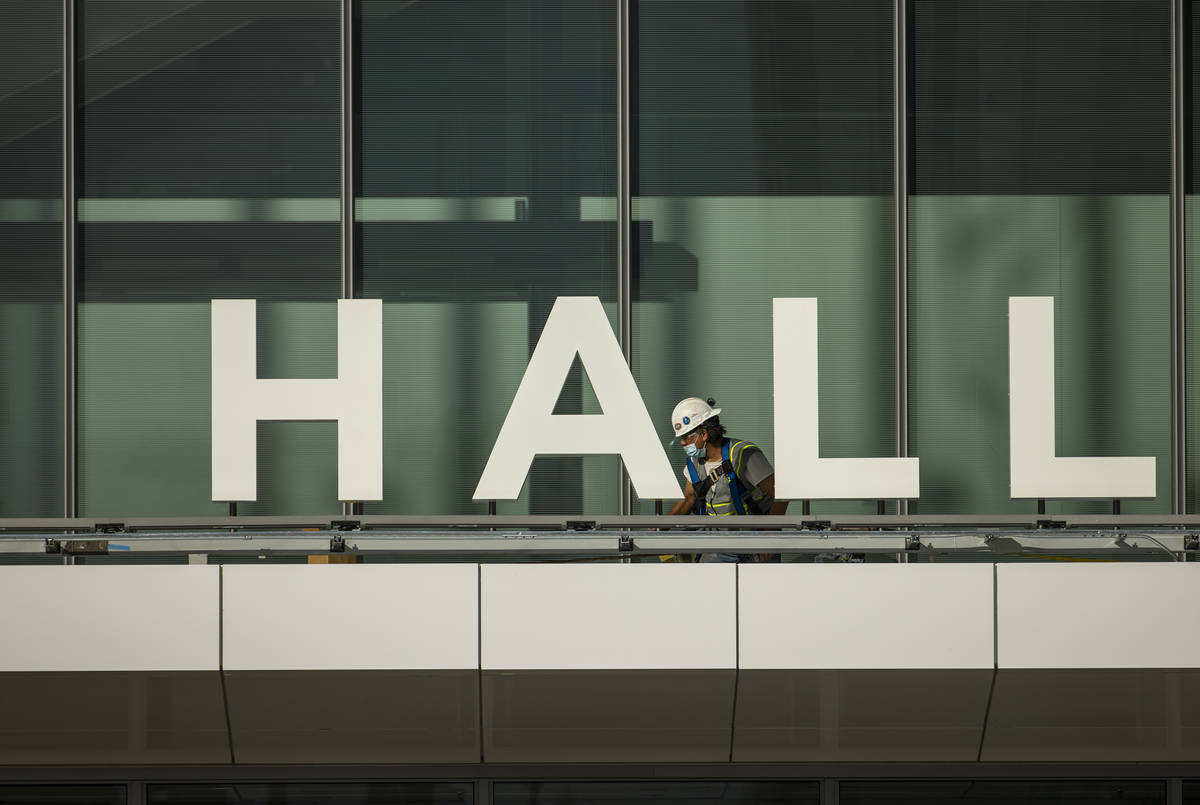 A worker moves about as construction continues out front of the new Las Vegas Convention Center ...
