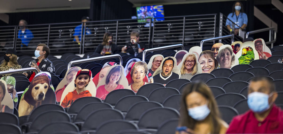 Fans are surrounded by cardboard cut outs in the stands before the first half of the UNLV Rebel ...