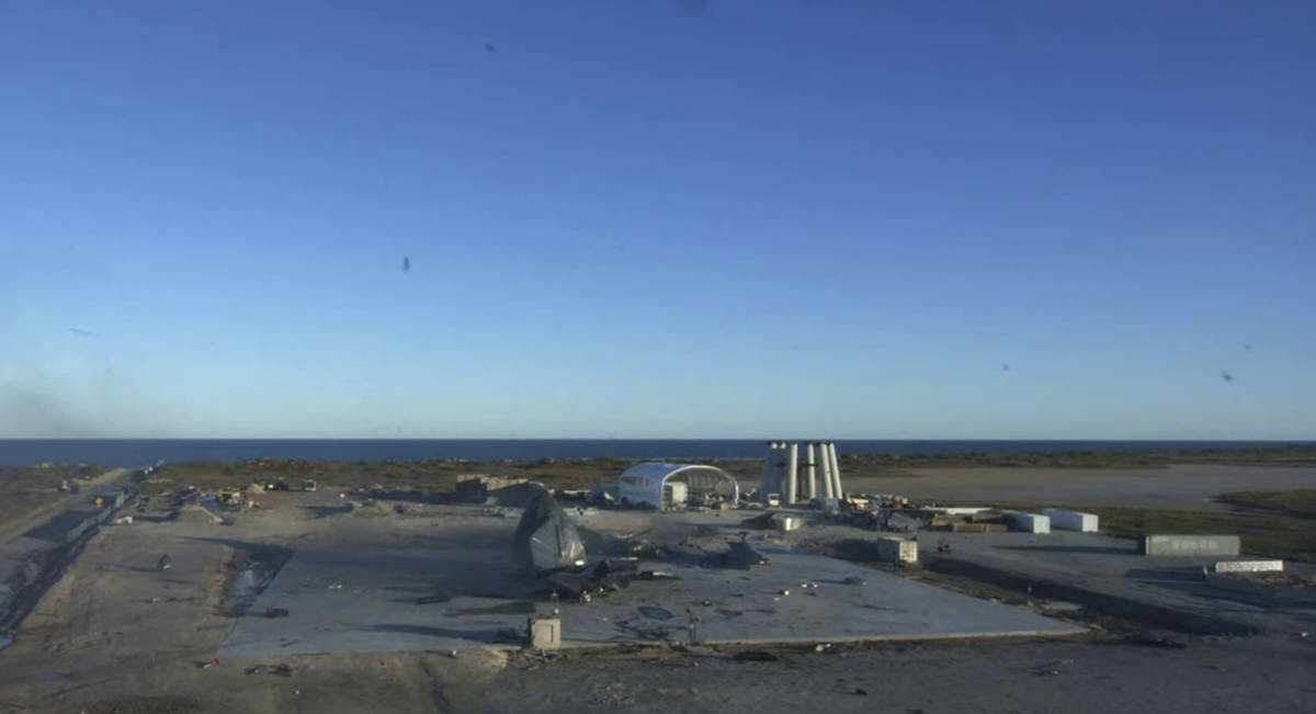 In this screen grab from video posted by SpaceX, the remains of the company's Starship are seen ...