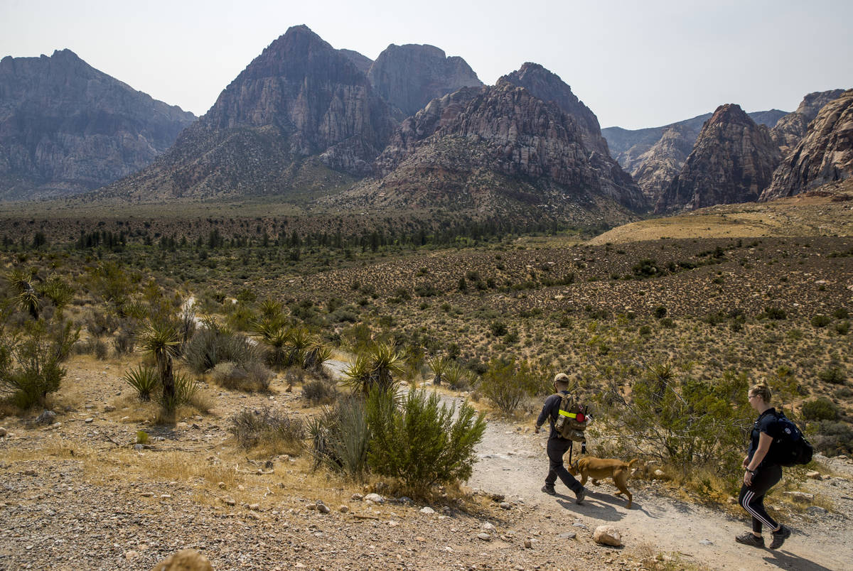 Hikers make their way along the Pine Creek Canyon trail in the Red Rock Canyon National Recreat ...