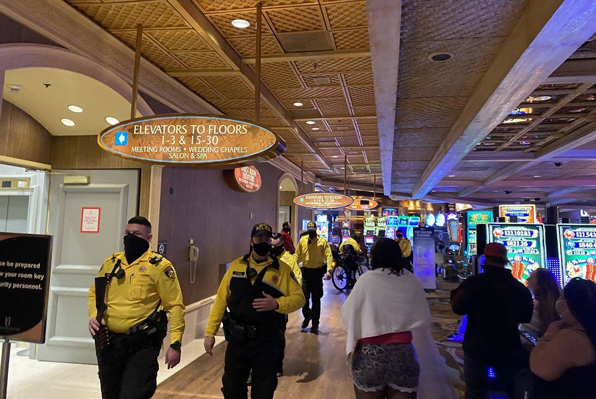 Las Vegas police leave Treasure Island on the casino floor after investigating reports of a gun ...