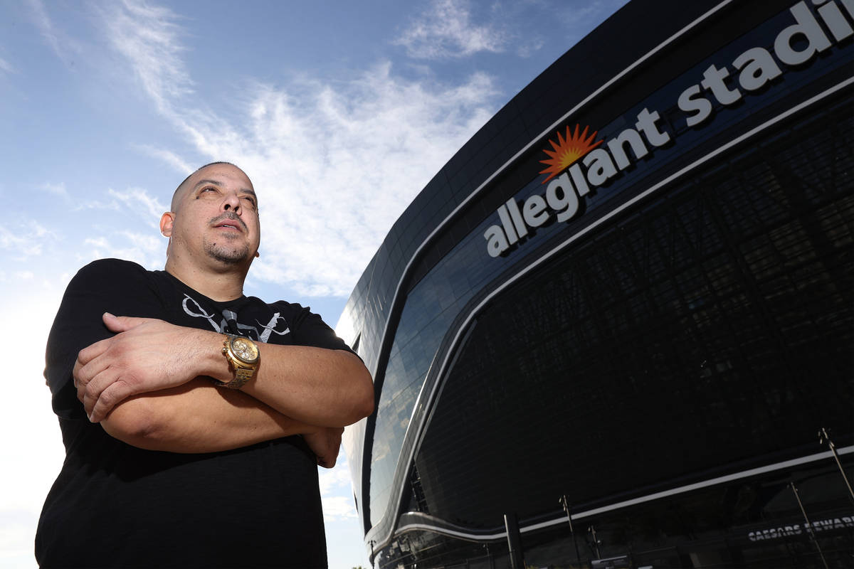 Rick Gonzalez, also known G Minor the DJ, poses for a portrait at Allegiant Stadium in Las Vega ...