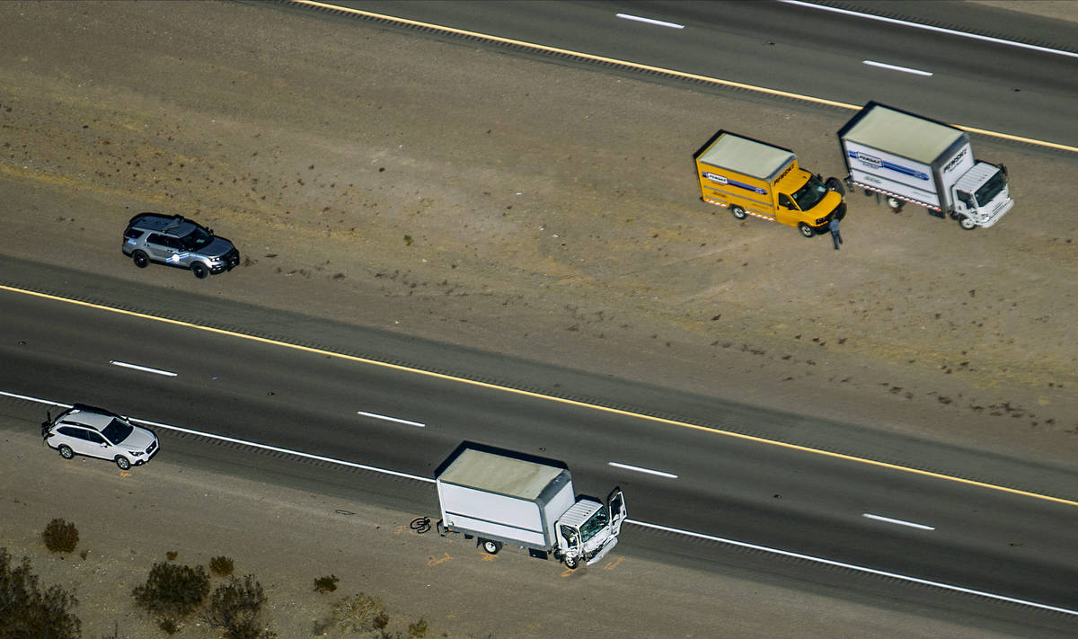 Damage to a truck is evident as the Nevada Highway Patrol works the scene of a fatal crash invo ...