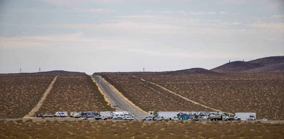Trucks are staged at the Nelson Road cutoff as the Nevada Highway Patrol works the scene of a f ...
