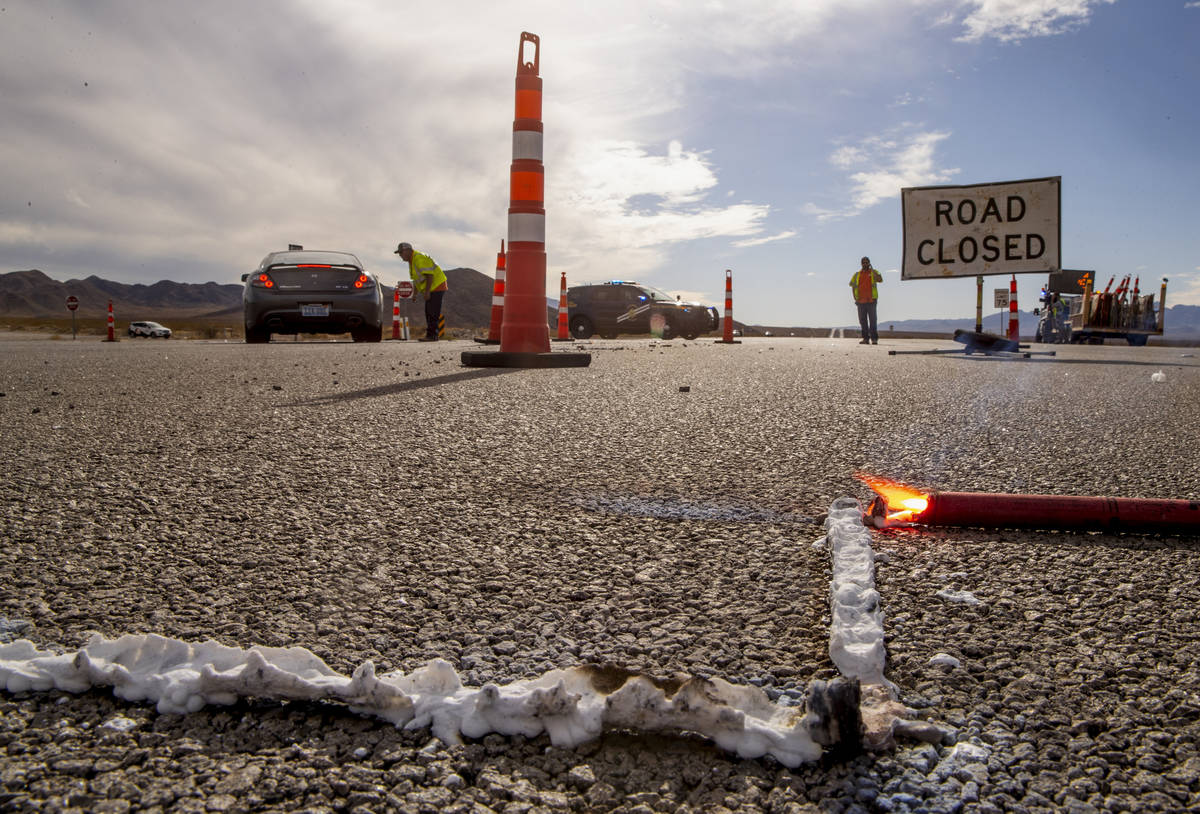 Traffic is redirected at the Nelson Road cutoff as the Nevada Highway Patrol works the scene of ...