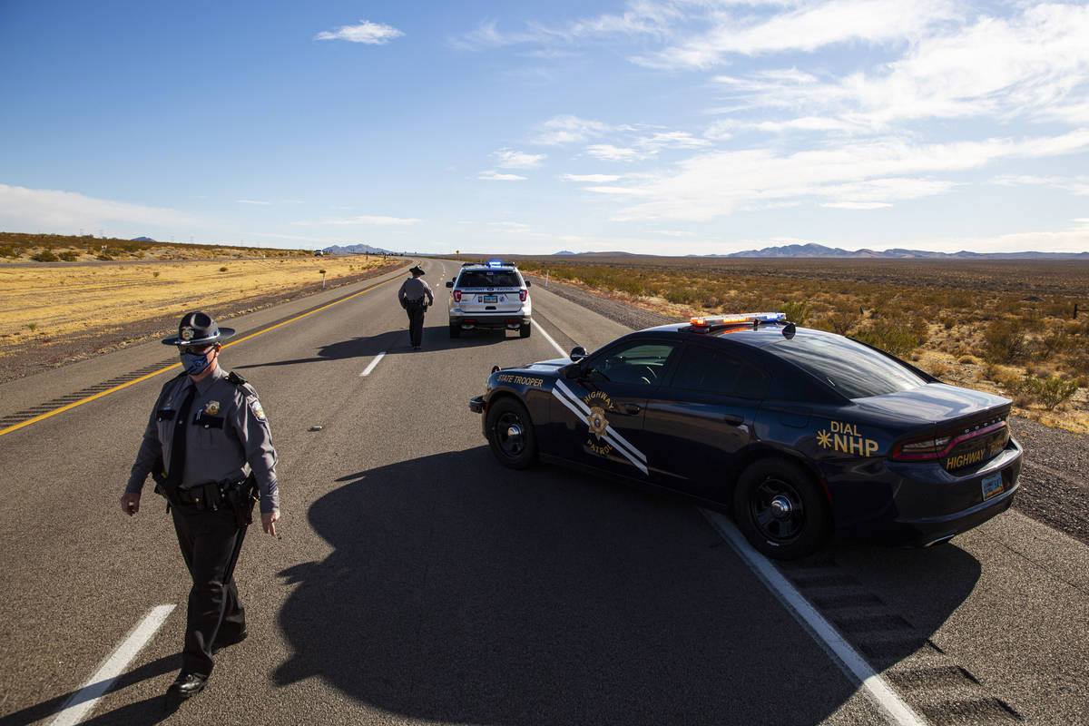 Nevada Highway Patrol troopers respond to the scene of a crash that left five bicyclists dead o ...
