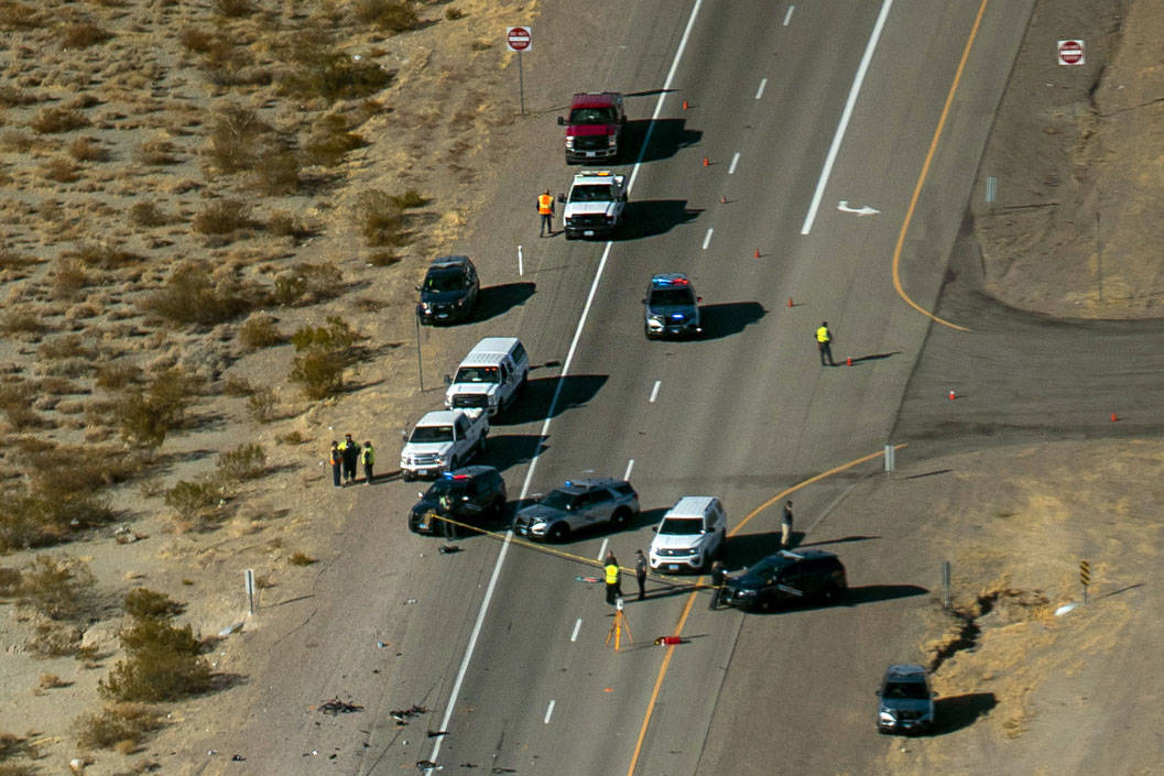 The Nevada Highway Patrol works the scene of a fatal crash involving multiple bicyclists and a ...