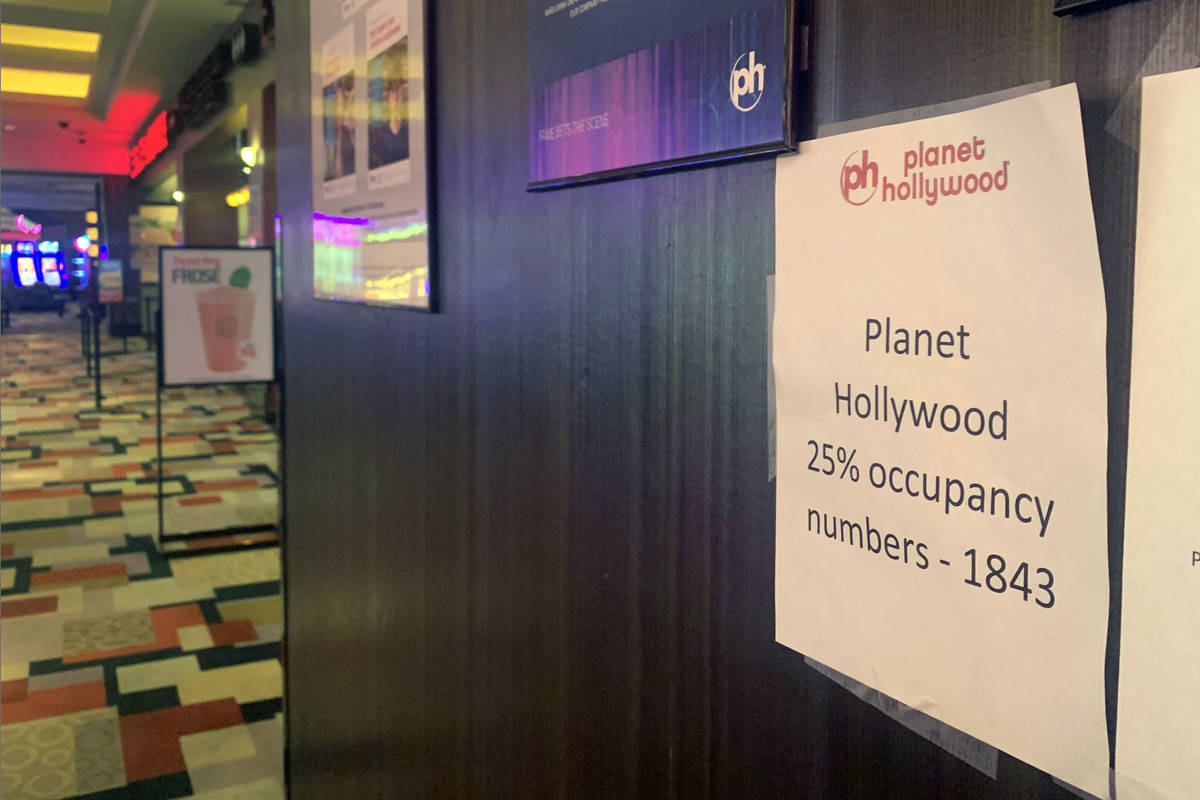 A 25 percent occupancy sign is posted at an entrance of Planet Hollywood on the Las Vegas Strip ...