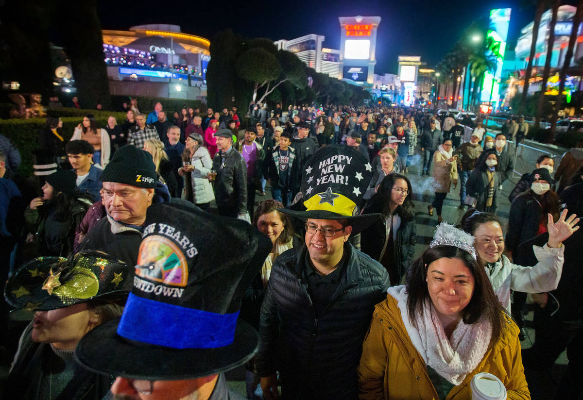 The Las Vegas Strip is packed with New Year's Eve partygoer, Dec. 31, 2019. (Benjamin Hager/Las ...