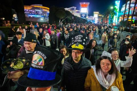 The Las Vegas Strip is packed with New Year's Eve partygoers, Dec. 31, 2019. (Benjamin Hager/La ...