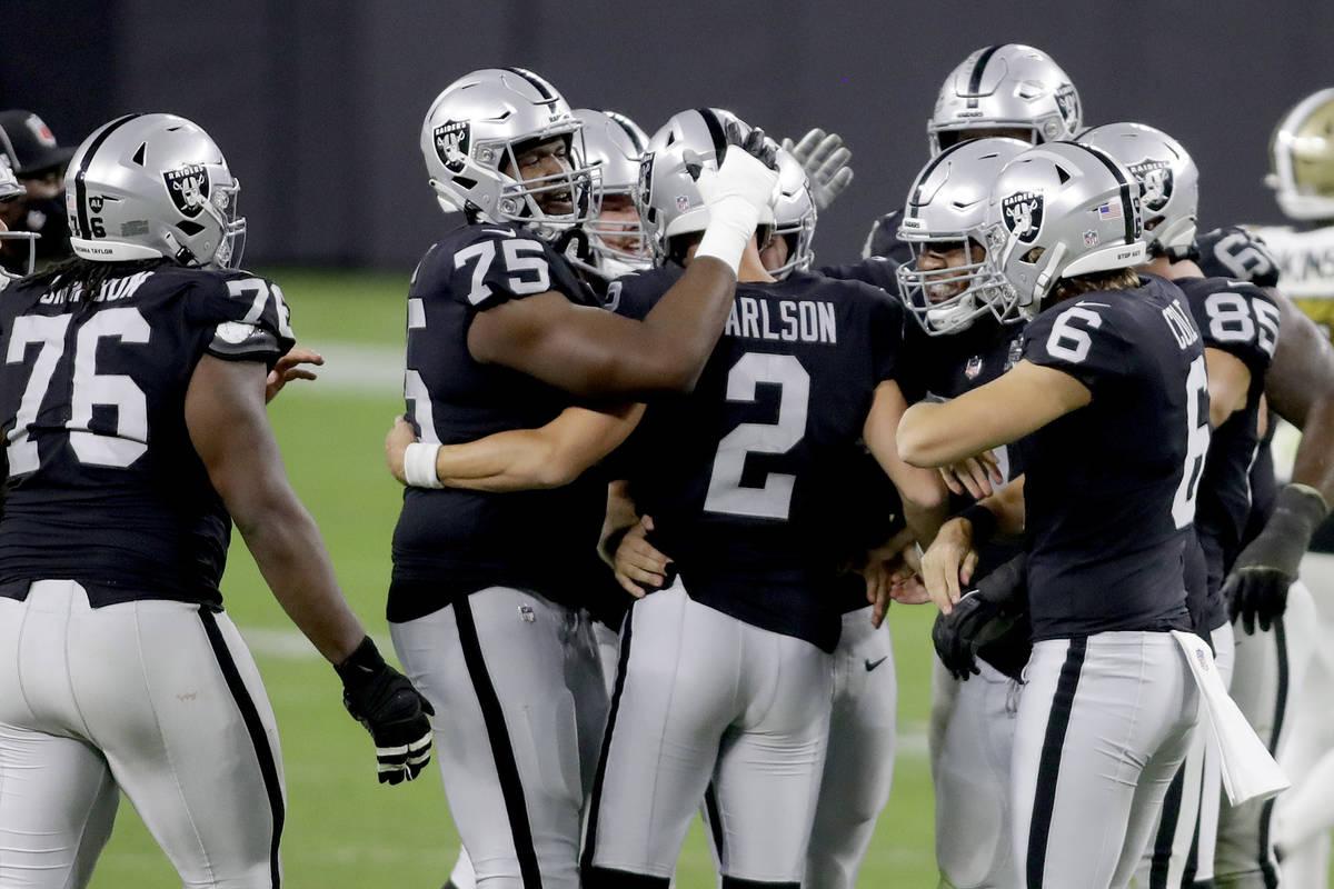 Las Vegas Raiders players celebrate after kicker Daniel Carlson (2) scored a 54 yard field goal ...