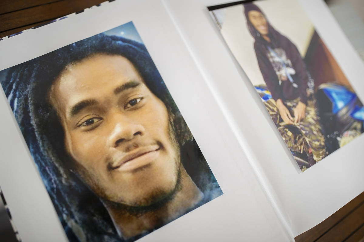 A book of photos of Genesis Atkins in the lobby of Hites Funeral Home and Crematory during a me ...