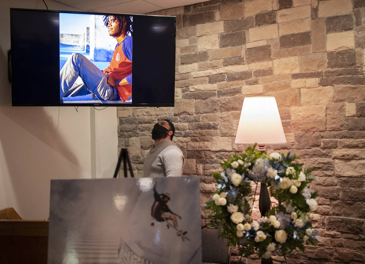 Malu Seiuli looks at a photo of Genesis Atkins during a memorial service for the competitive s ...