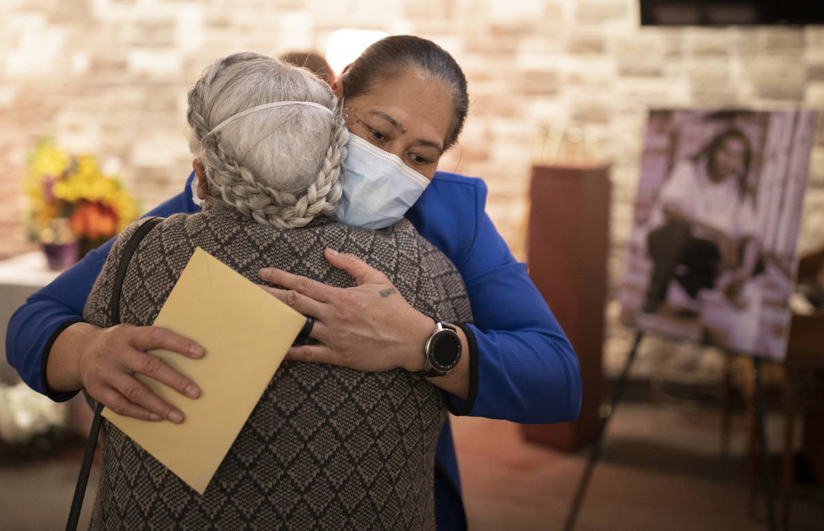 Evelini Gibbs, mother of Genesis Atkins, gets a hug during a memorial service for her son on S ...