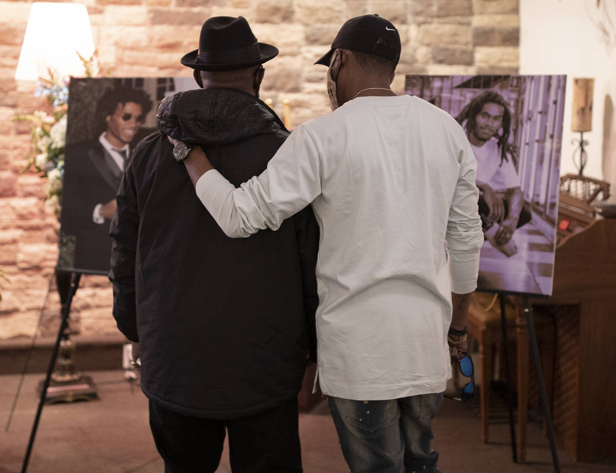 Steve Atkins, left, father of Genesis Atkins, is consoled by a friend during a memorial service ...