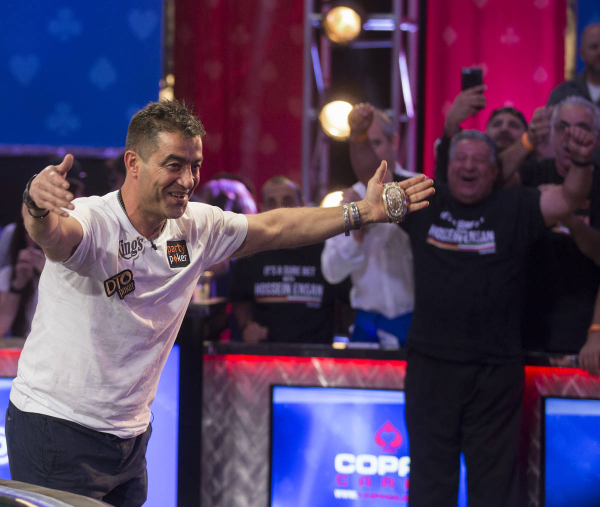 Hossein Ensan, left, from Germany, bows to his fans after winning the World Series of Poker Mai ...