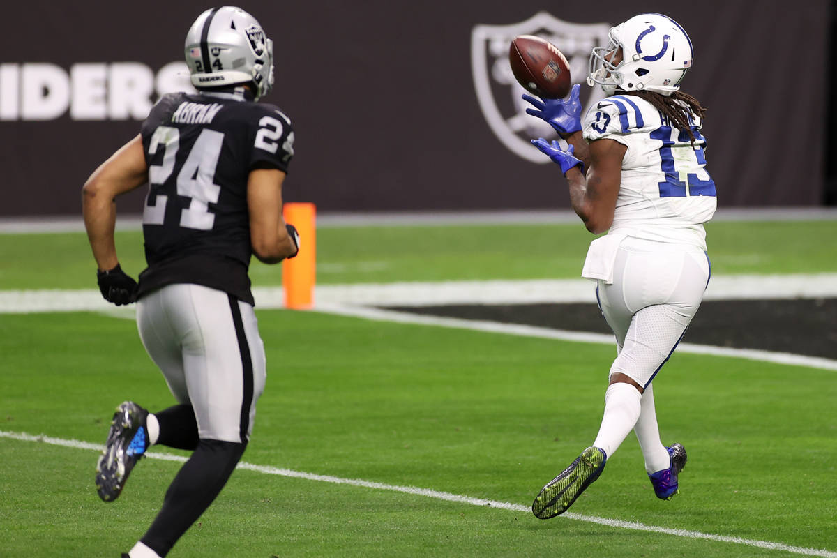Indianapolis Colts wide receiver T.Y. Hilton (13) makes a touchdown catch under pressure from R ...