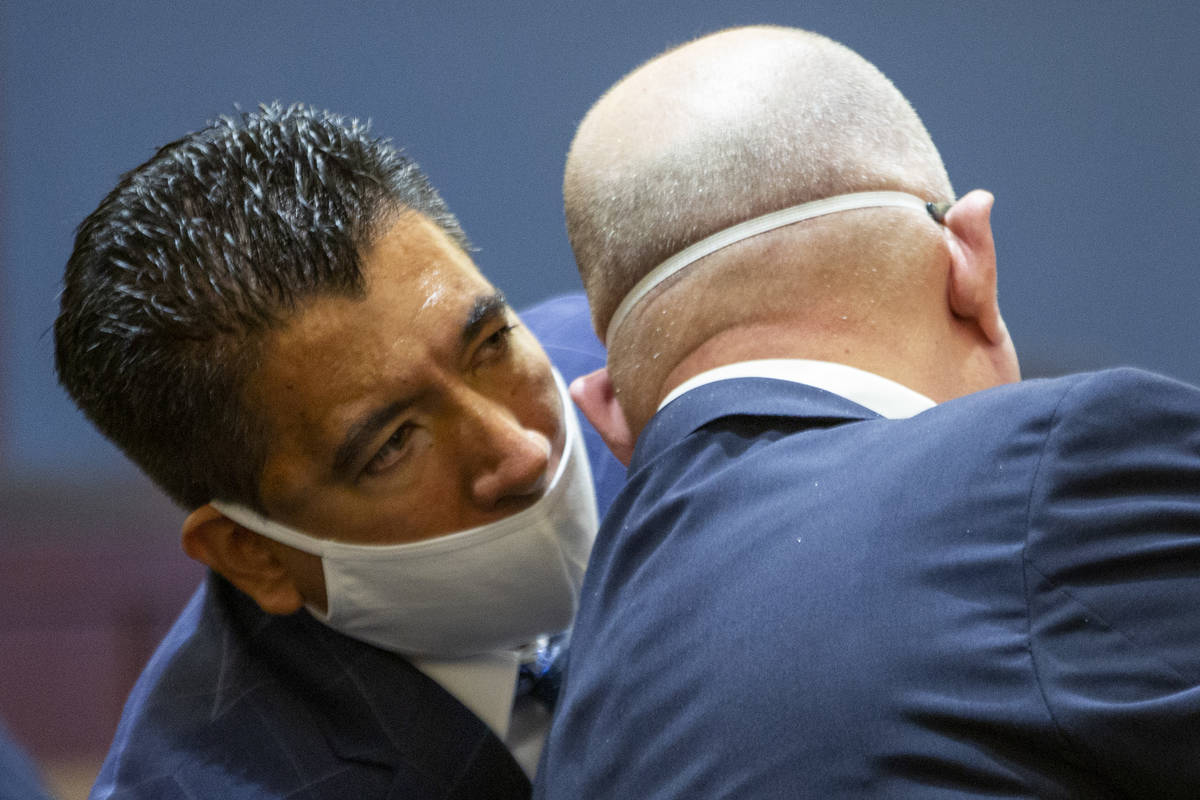Alpine Motel Apartments owner Adolfo Orozco speaks to his attorney Dominic Gentile during a con ...