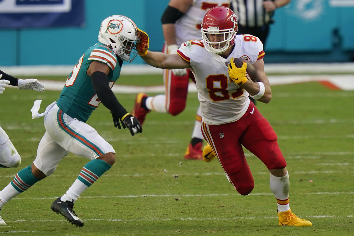 Kansas City Chiefs tight end Travis Kelce (87) stops Miami Dolphins free safety Brandon Jones ( ...