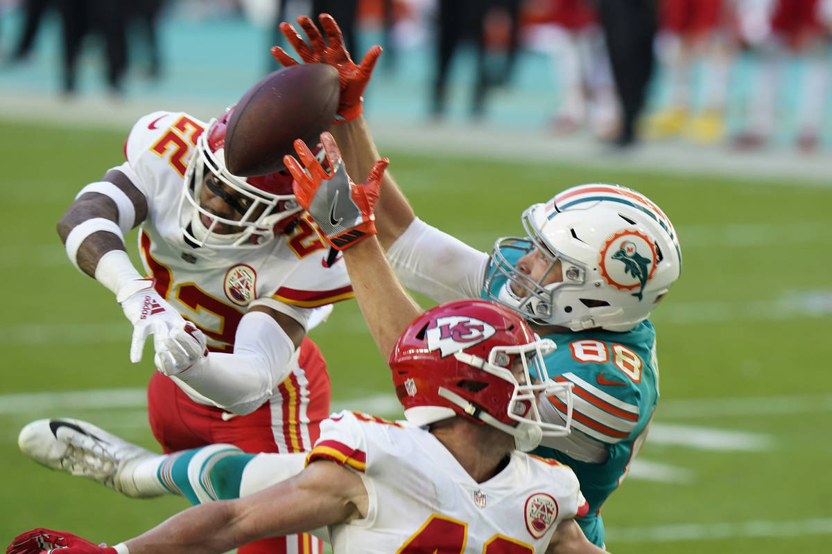 Miami Dolphins tight end Mike Gesicki (88) catches a touchdown pass, during the second half of ...