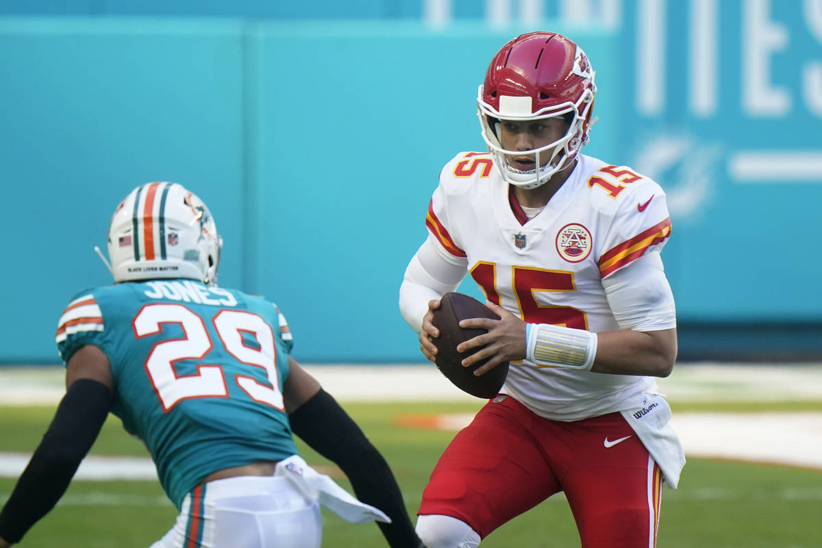 Kansas City Chiefs quarterback Patrick Mahomes (15) looks to pass the football during the first ...