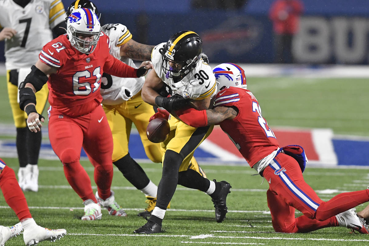 Buffalo Bills free safety Jordan Poyer, right, forces a fumble by Pittsburgh Steelers running b ...
