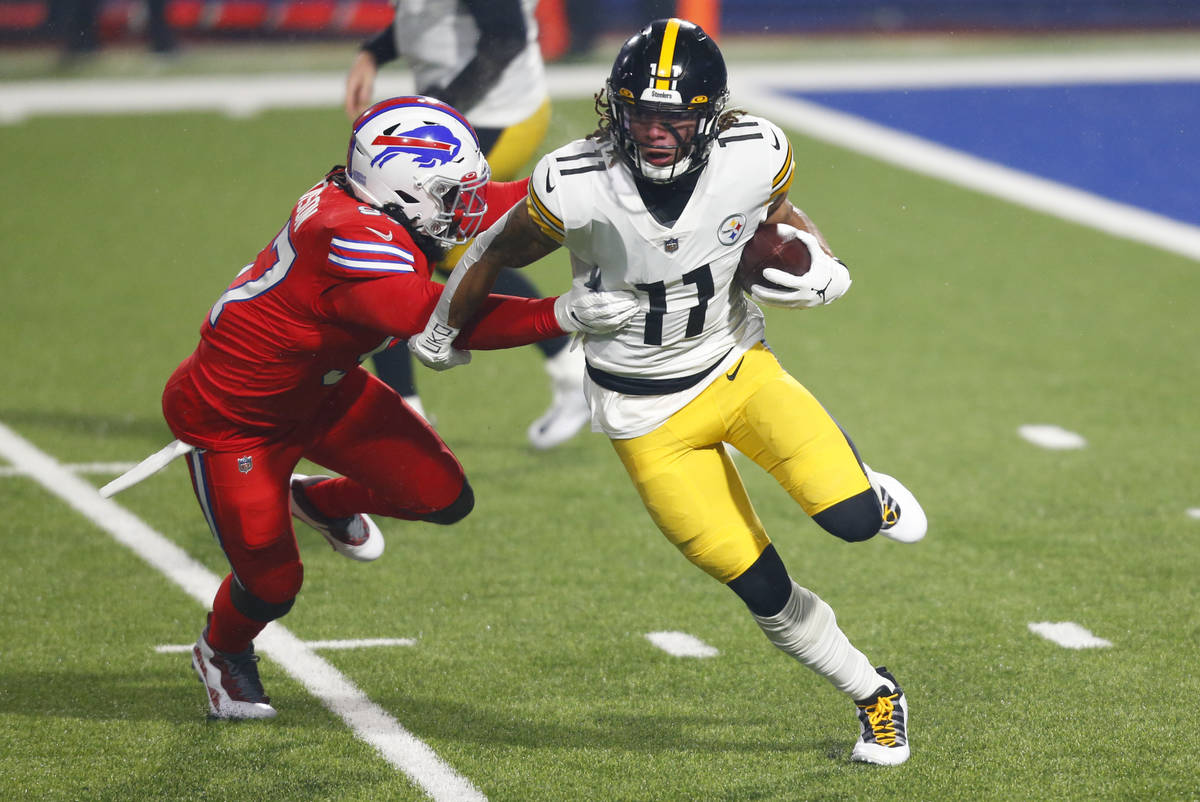 Pittsburgh Steelers wide receiver Chase Claypool (11) gets past Buffalo Bills defensive end Mar ...