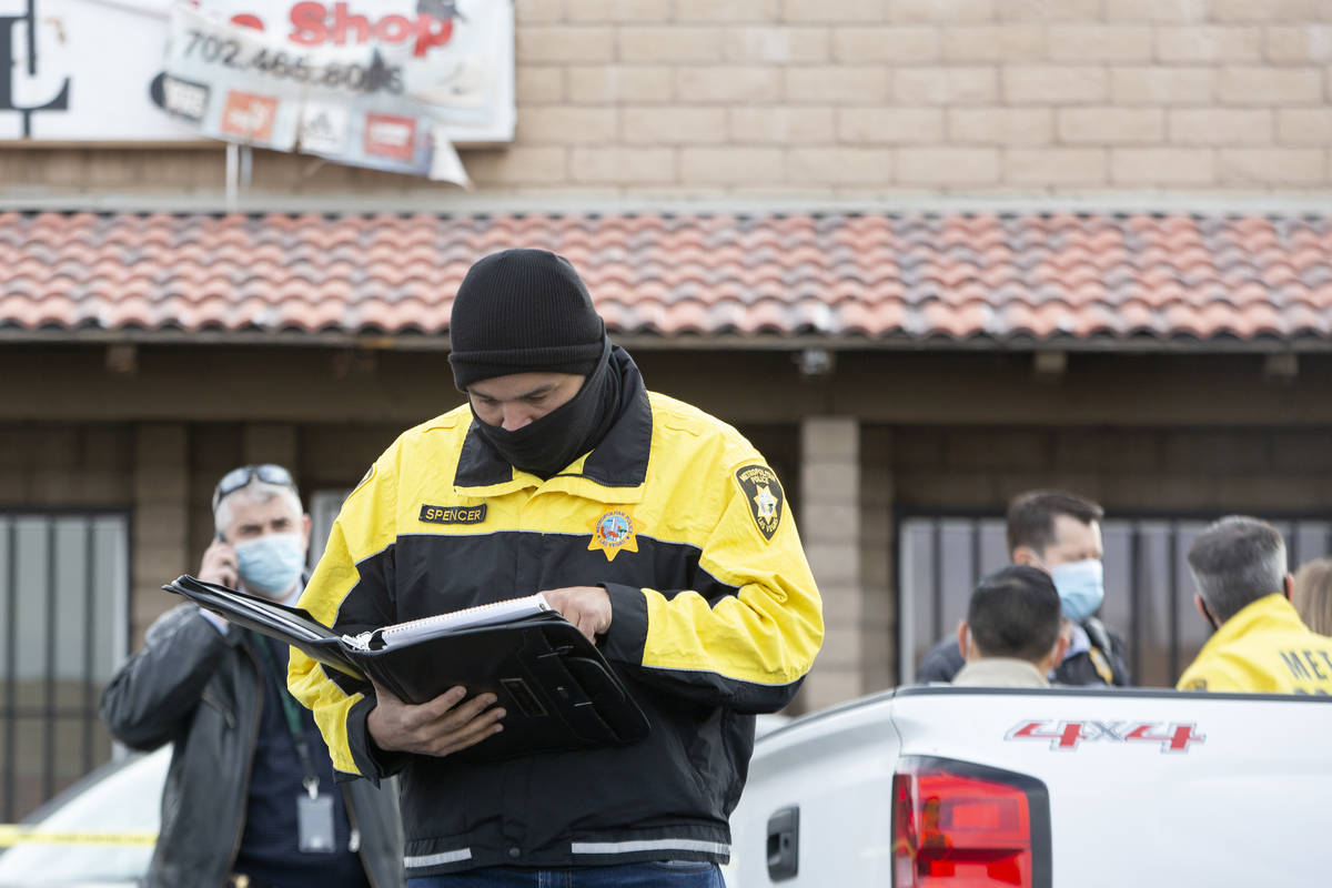 Homicide Lt. Ray Spencer reviews the case before briefing the press on the investigation of a h ...