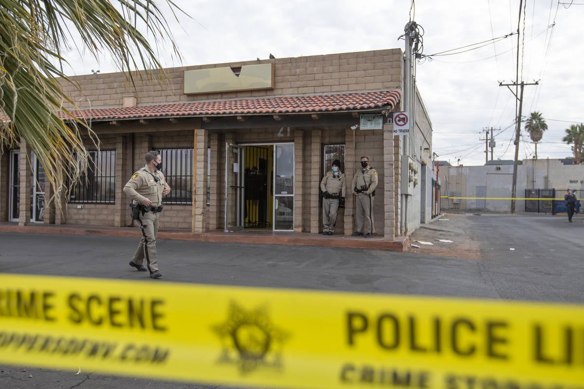 Metropolitan police investigate a homicide in the 3000 block of Contract Avenue on Sunday, Dec. ...