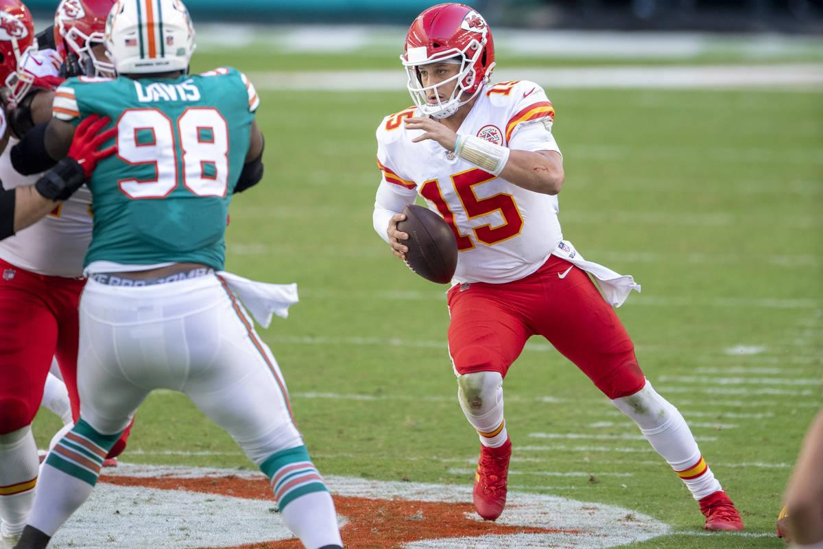 Kansas City Chiefs quarterback Patrick Mahomes (15) scrambles with the ball against Miami Dolph ...