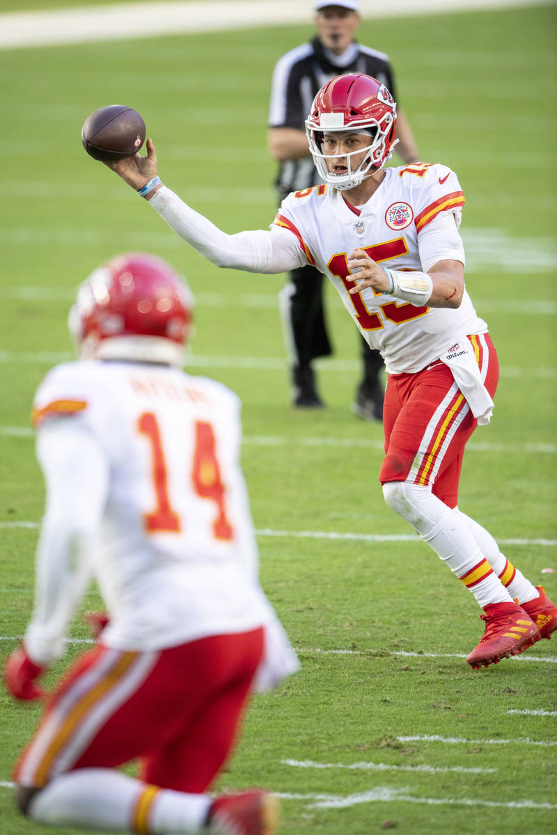 Kansas City Chiefs quarterback Patrick Mahomes (15) throws the ball to Kansas City Chiefs wide ...