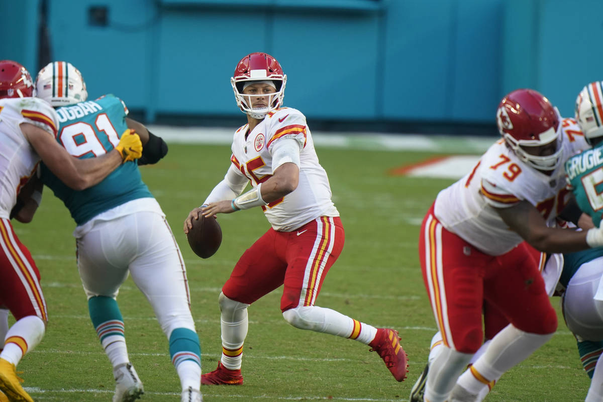 Kansas City Chiefs quarterback Patrick Mahomes (15) aims a pass, during the second half of an N ...