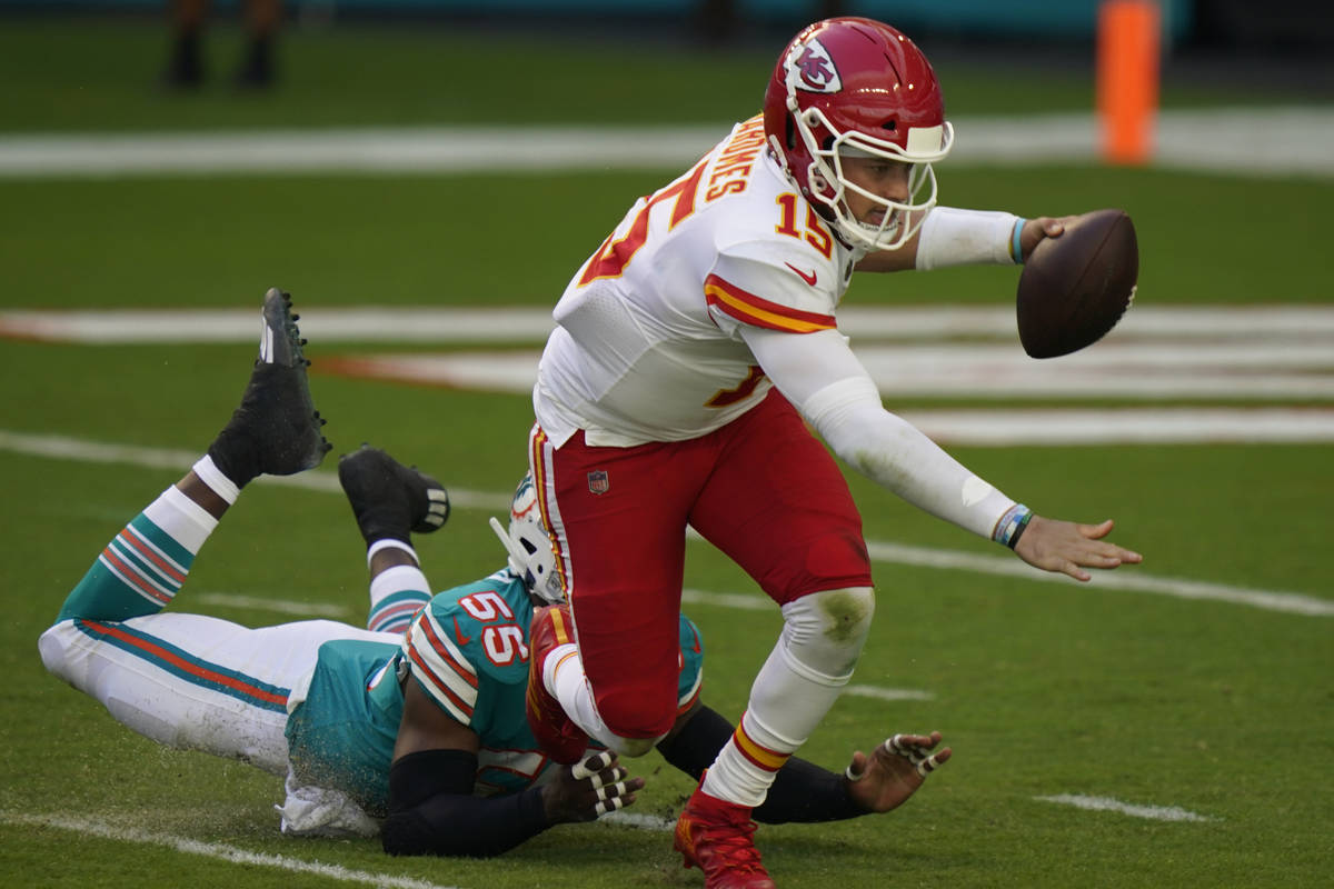 Kansas City Chiefs quarterback Patrick Mahomes (15) falls on the field after he was sacked by M ...