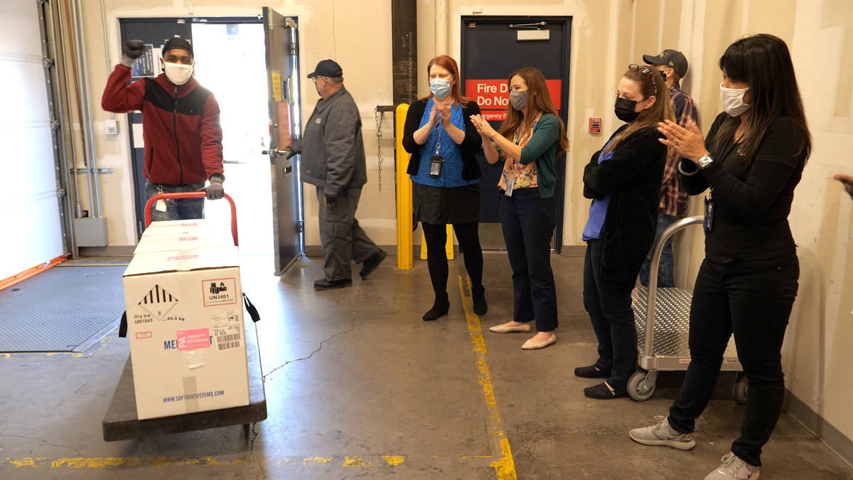 The first doses of COVID-19 vaccine arrive at the Southern Nevada Health District on Monday, De ...