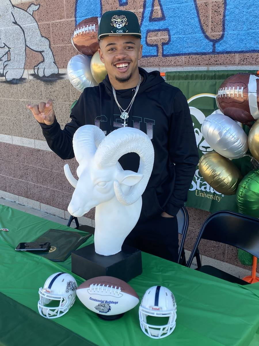 Centennial wide receiver Gerick Robinson poses with a ram statue he received from his youth coa ...